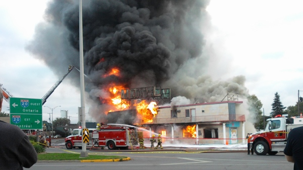 The hellish conflagration claimed the creaky motel and strip club structure at about 7 a.m. Sunday morning. Officials believe it might have been a suspicious blaze. (Photo courtesy MyNews contributor Sean Miller)