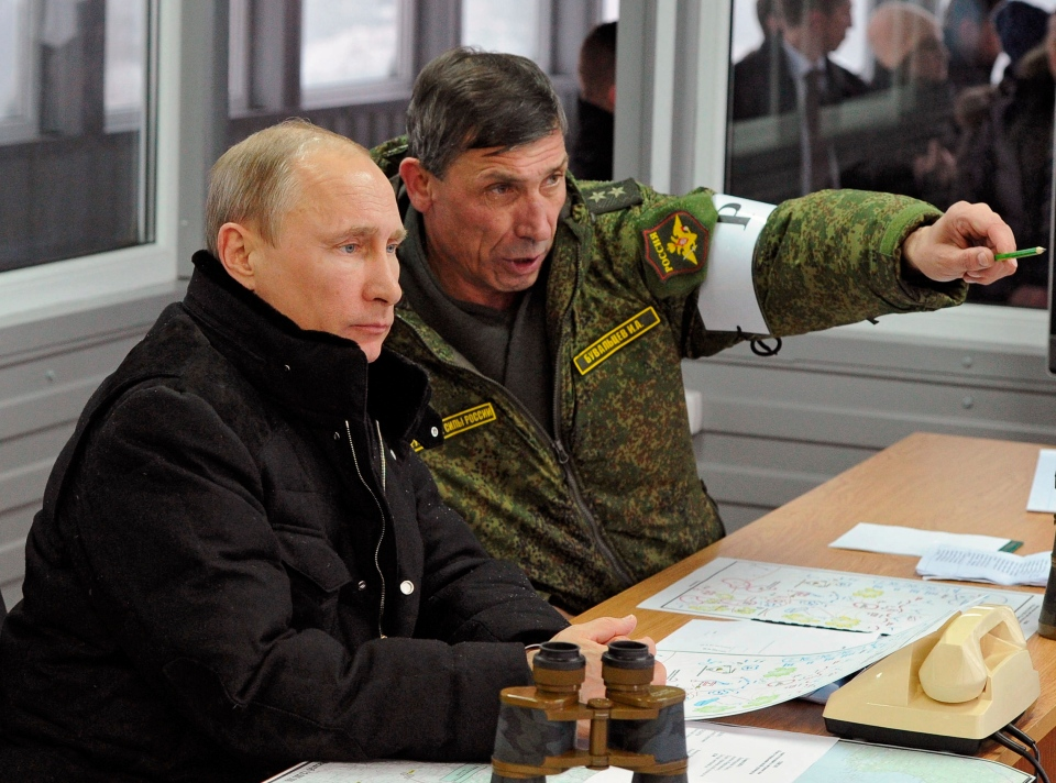 Russian President Vladimir Putin, listens to Gen. Ivan Buvaltsev, right, as they observe a military exercise near St. Petersburg, Russia, Monday, March 3, 2014. (RIA-Novosti, Mikhail Klimentyev, Presidential Press Service)