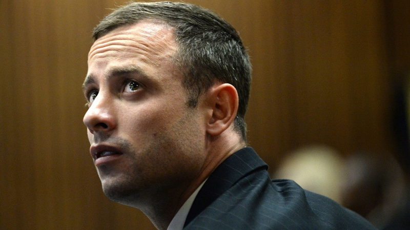 Oscar Pistorius sits in the dock on the second day of his trial at the high court in Pretoria, South Africa, Tuesday, March 4, 2014. (AP / Antoine de Ras)