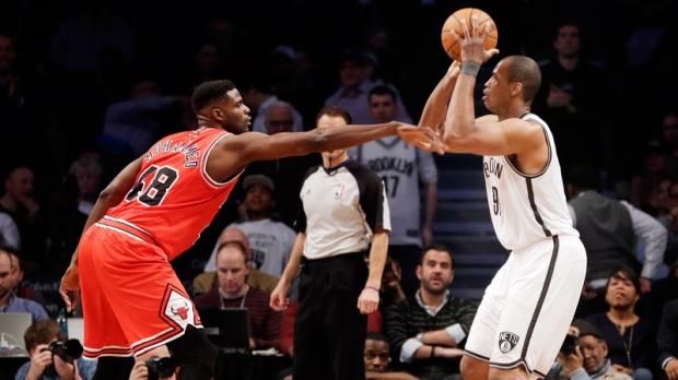 Brooklyn Nets' Jason Collins takes a shot