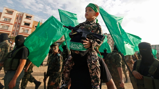 Hamas militia march in Nuseirat Refugee Camp