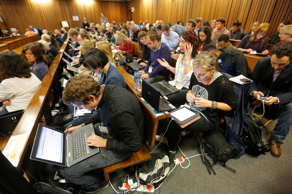 Members of the public and members of the media cover the second day of the Oscar Pistorius trial at the high court in Pretoria, South Africa, Tuesday, March 4, 2014. (AP / Kim Ludbrook)