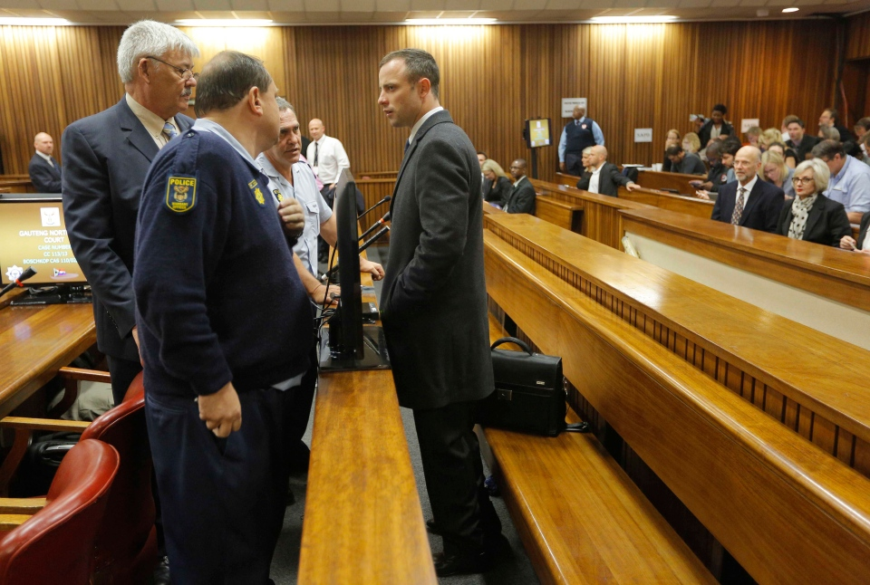 Oscar Pistorius stands inside court for the second day of his trial at the high court in Pretoria, South Africa, Tuesday, March 4, 2014. (AP / Kim Ludbrook)