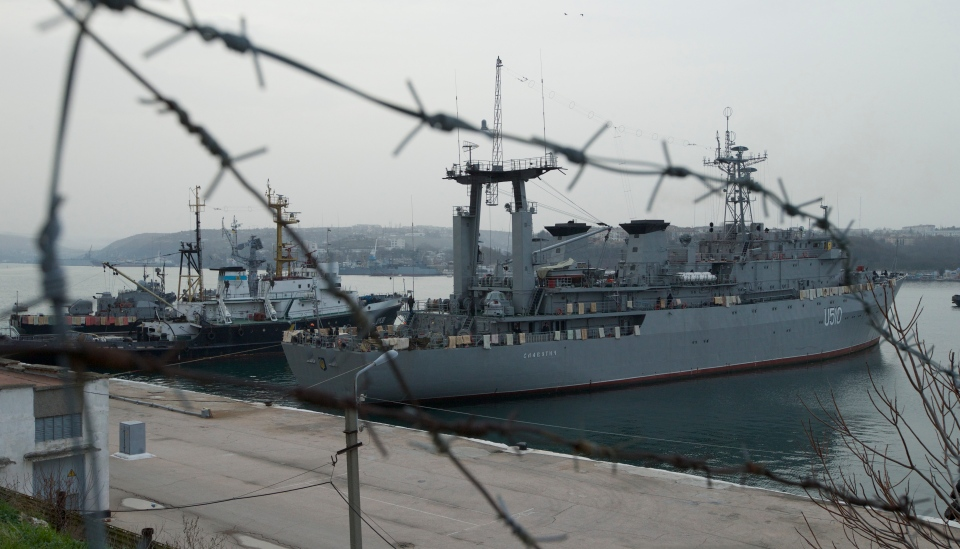 Ukrainian naval ships Slavutich, right, and Ternopil, left, in dock in Sevastopol, Ukraine, on Tuesday, March 4, 2014. The blankets and mattresses are placed over the side of the ship to hinder any attempted assault. (AP / Ivan Sekretarev)