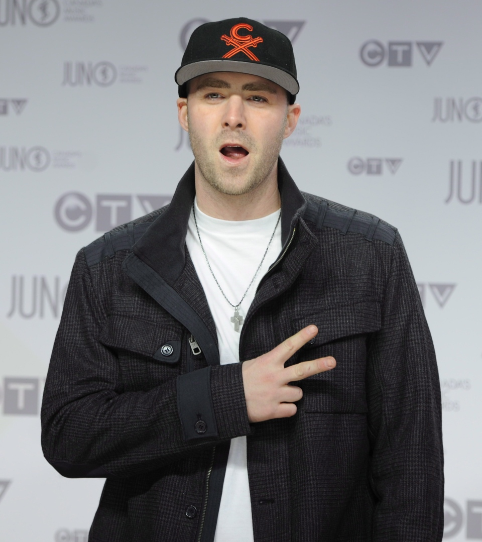 Rapper Classified pose for photographers as he arrives on the red carpet at the Juno Awards in Ottawa, Sunday, April 1, 2012. (Sean Kilpatrick / THE CANADIAN PRESS)