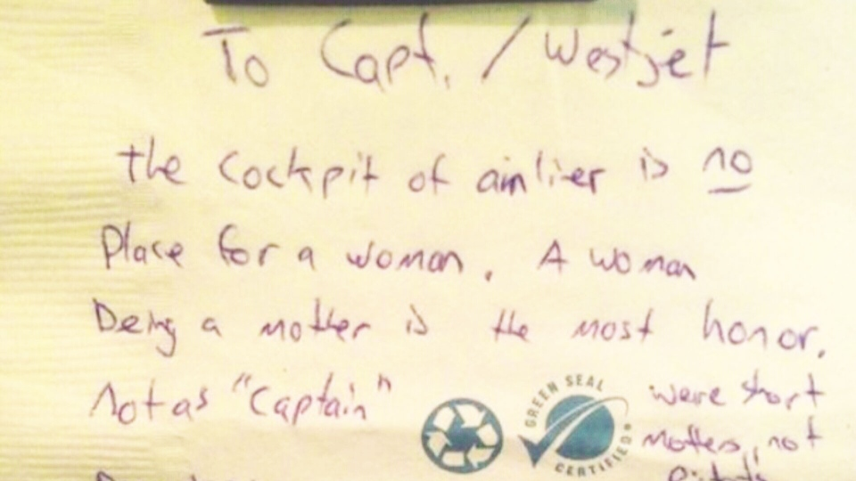 A note left by a WestJet passenger on a Calgary to Victoria flight is seen in this image taken from video.