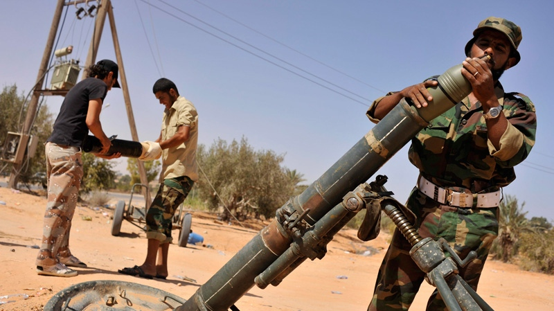 libya revolution fighters, sirte, gadhafi stronghold