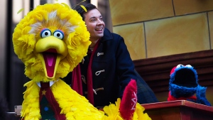 Television personality Jimmy Fallon rides on a float alongside Seasame Street's Big Bird, left, and Cookie Monster, right, during the 87th Annual Macy's Thanksgiving Day Parade, Thursday, Nov. 28, 2013, in New York. (AP / John Minchillo)