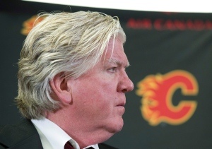 Brian Burke, Calgary Flames' president of hockey operations, announces the firing of GM Jay Feaster and assistant GM John Weisbrod at a press conference in Calgary, Alta., Thursday, December 12, 2013. (Larry MacDougal / THE CANADIAN PRESS)