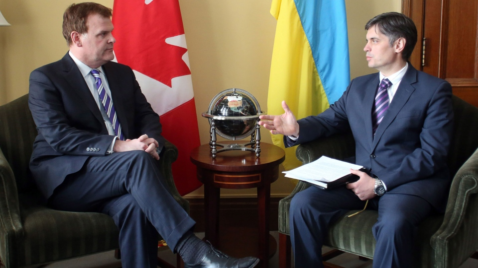 Canadian Foreign Affairs Minister John Baird (left) meets with Vadym Prystaiko, Ukrainian Ambassador to Canada, on Parliament Hill in Ottawa, Tuesday, March 4 2014. (Fred Chartrand / THE CANADIAN PRESS)