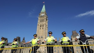Hundreds of police patrol Parliament Hill before protest