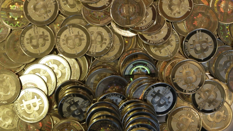 This April 3, 2013 file photo shows bitcoin tokens in Sandy, Utah. (AP / Rick Bowmer)