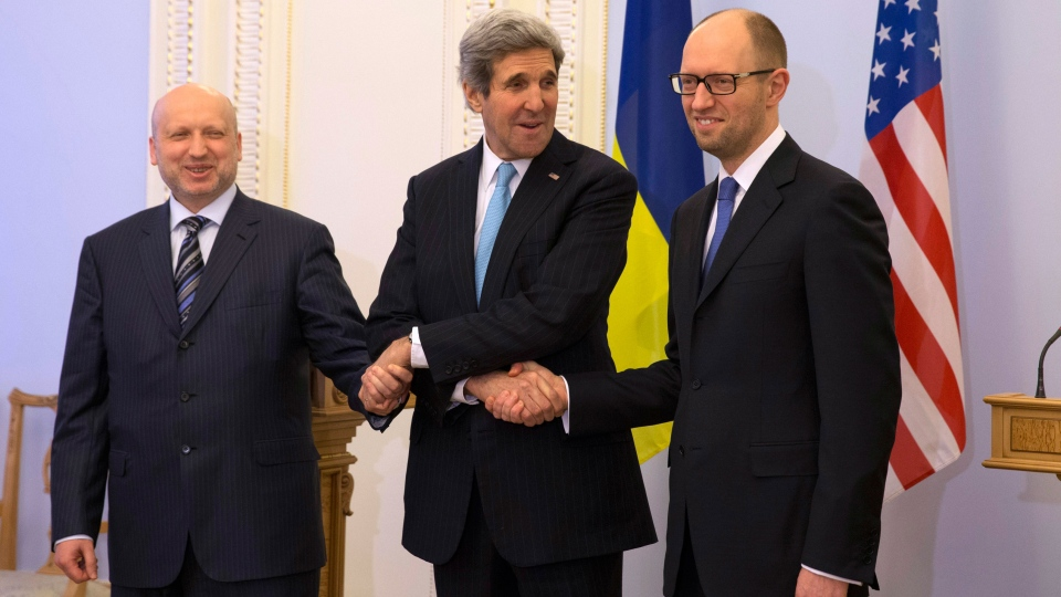 Secretary of State John Kerry meets with Acting Ukraine President Oleksandr Turchynov, left, and Prime Minister Arseniy Yatsenyuk, at the Rada in Kyiv, Ukraine, Tuesday, March 4, 2014. (AP / Kevin Lamarque)