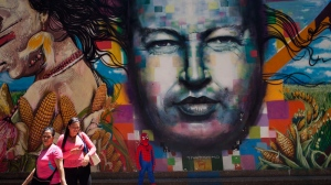 A mural of Venezuela's late President Hugo Chavez painted on a wall of the Museo de Bellas Artes in Caracas, Venezuela, Tuesday, March 4, 2014. (AP Photo/Rodrigo Abd)