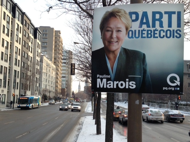 Posters for the yet-to-be called Quebec election began going up Tuesday night. A new poll suggests the race between the Parti Quebecois and Liberals could be tight. (Christophe Terrade/CTV Montreal)