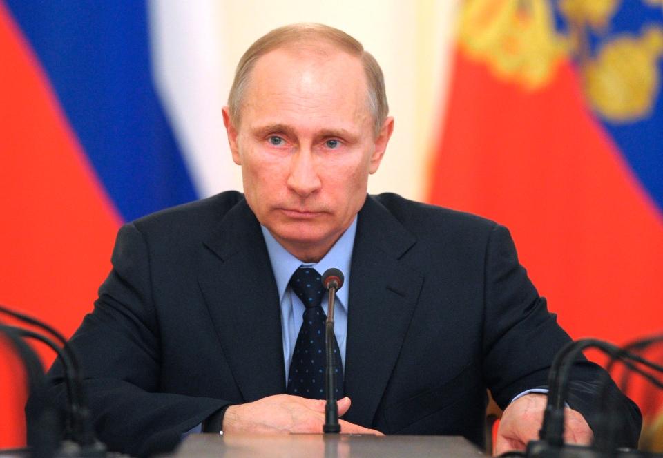 Russian President Vladimir Putin heads the Cabinet meeting at the Novo-Ogaryovo presidential residence outside Moscow on Wednesday, March 5, 2014. (AP/RIA Novosti, Alexei Druzhinin, Presidential Press Service)