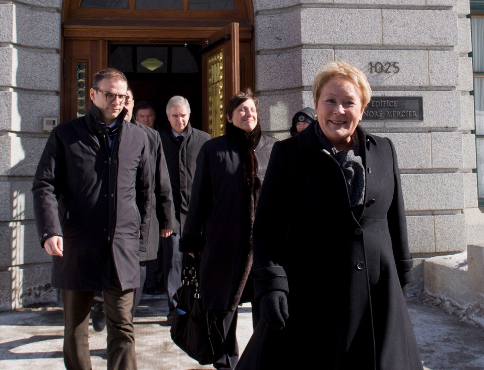 Quebec Premier and Parti Quebecois Leader Pauline Marois walks to the Lt. Governor's office to call for a provincial election in Quebec City, Wednesday, March 5, 2014. (Jacques Boissinot / THE CANADIAN PRESS)