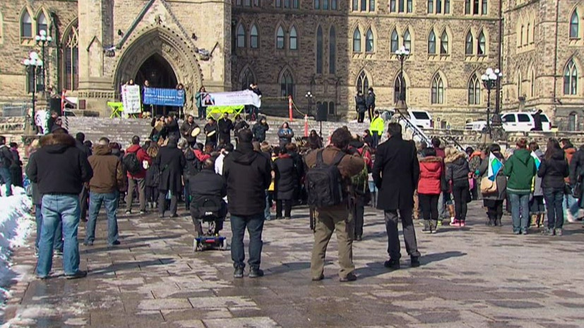 A crowd attends a vigil and rally for Loretta Saunders on Parliament Hill in Ottawa on Wednesday, March 5, 2014.