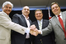 Infrastructure Minister Lawrence Cannon, Ontario Energy and Infrastructure Minister George Smitherman, Finance Minister Jim Flaherty and Ontario Finance Minister Dwight Duncan, shake hands after signing an infrastructure agreement in London, Ont., on Thursday July 24, 2008 (Dave Chidley / THE CANADIAN PRESS)