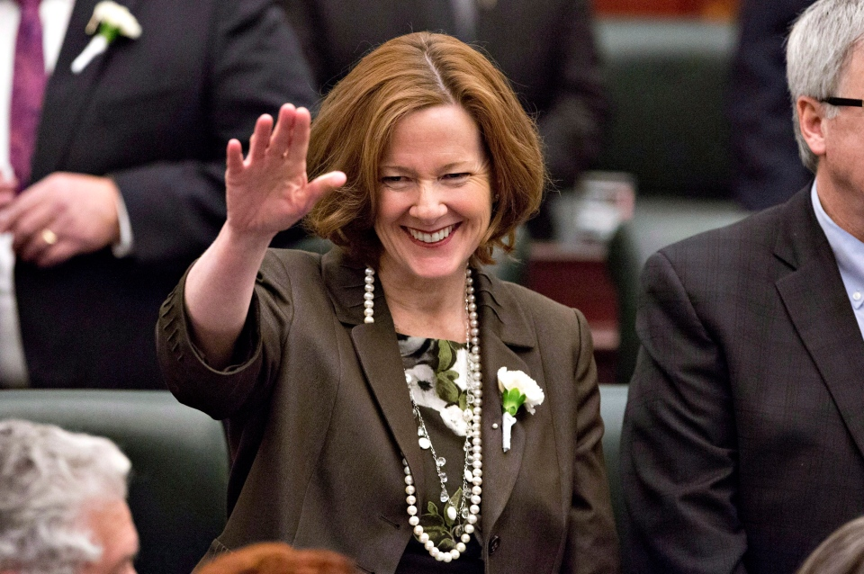 Alberta Premier Alison Redford waves to members of the legislative assembly before the throne speech at the Alberta Legislature in Edmonton on March 3, 2014. (Jason Franson/THE CANADIAN PRESS)