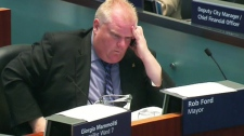 Toronto Mayor Rob Ford listens to the debate on the proposed service cuts during a special session at city hall, Monday, Sept. 26, 2011.