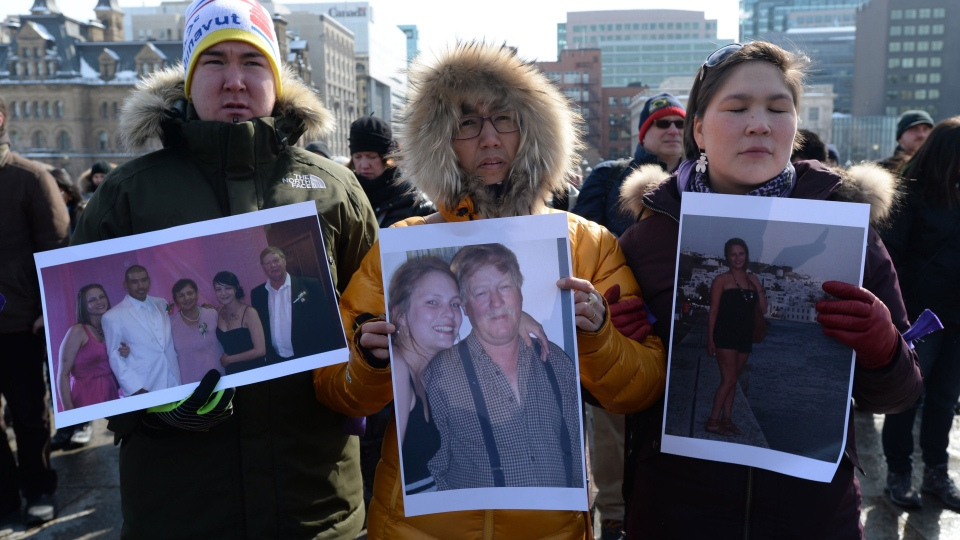 Hans Kristian Petrussen, of Greenland, left to right, Paninguak Kruse, of Greenland, and Ivana Josefsen, of Greenland, take part in a vigil on Parliament Hill in Ottawa on Wednesday, March 5, 2014, for Loretta Saunders and to call for a national inquiry into missing and murdered aboriginal women. (Sean Kilpatrick / THE CANADIAN PRESS)