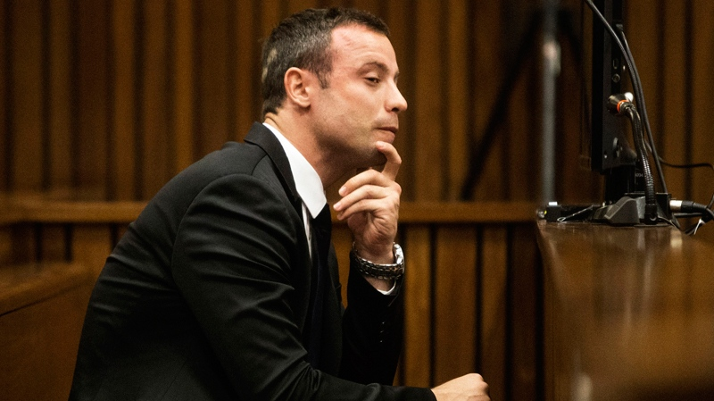 Oscar Pistorius sits in the dock on the fourth day of his trial at the high court in Pretoria, South Africa, Thursday, March 6, 2014. (AP / Marco Longari)