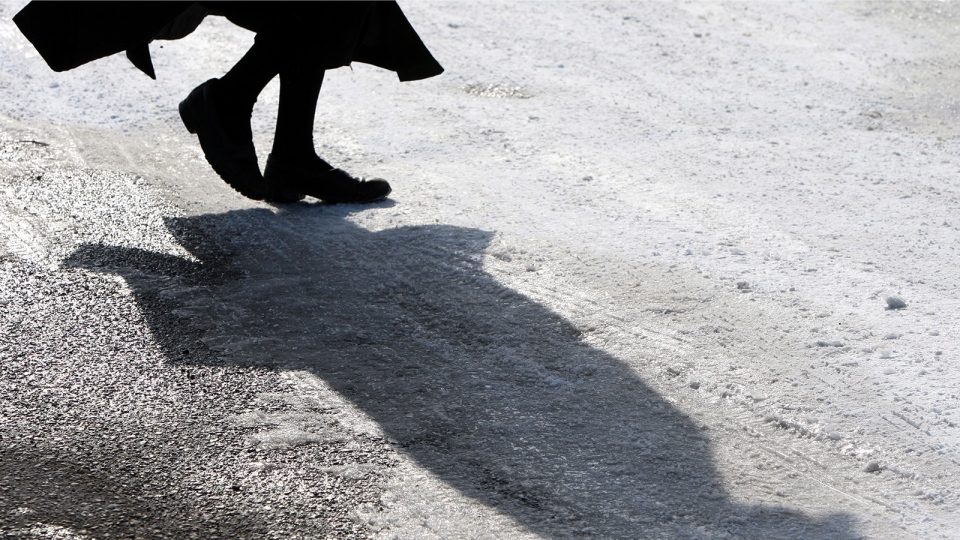 A member of the Lev Tahor ultra-orthodox Jewish sect walk down a street while an emergency motion in the child custody case is held at the courthouse in Chatham, Ont., Wednesday, March 5, 2014. (THE CANADIAN PRESS / Dave Chidley)
