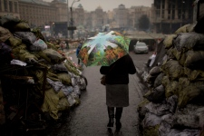 Woman walks through Kyiv square