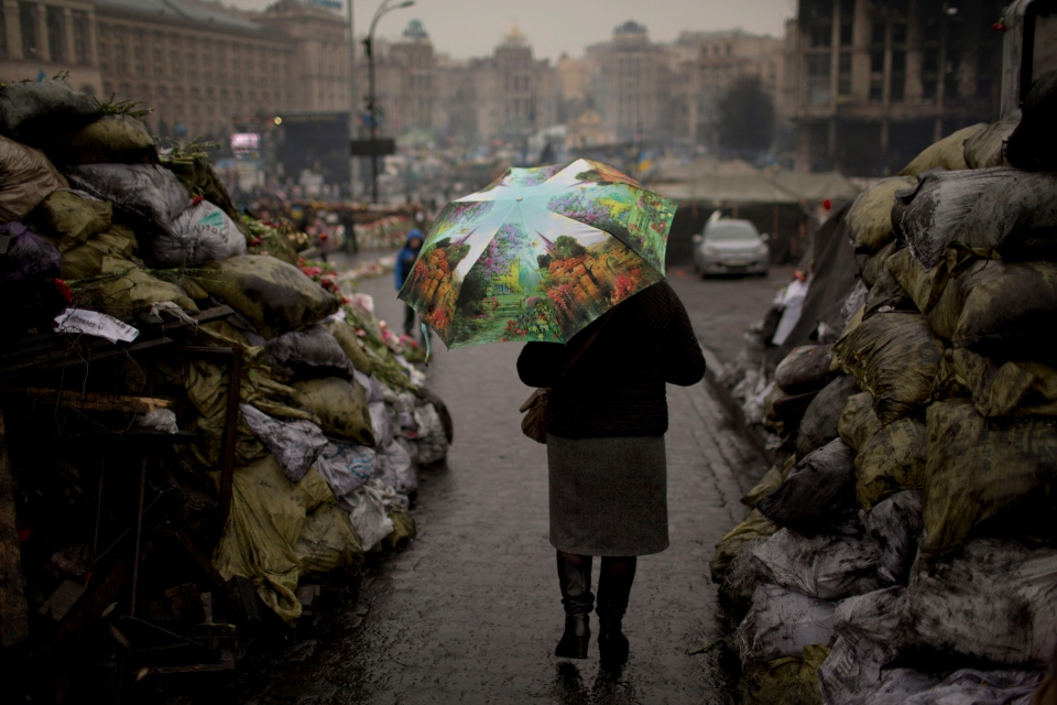 A woman walks past barricades set up by anti-Yanukovich protestors at Kyiv's Independence Square, in Ukraine, Thursday, March 6, 2014. (AP / Emilio Morenatti)