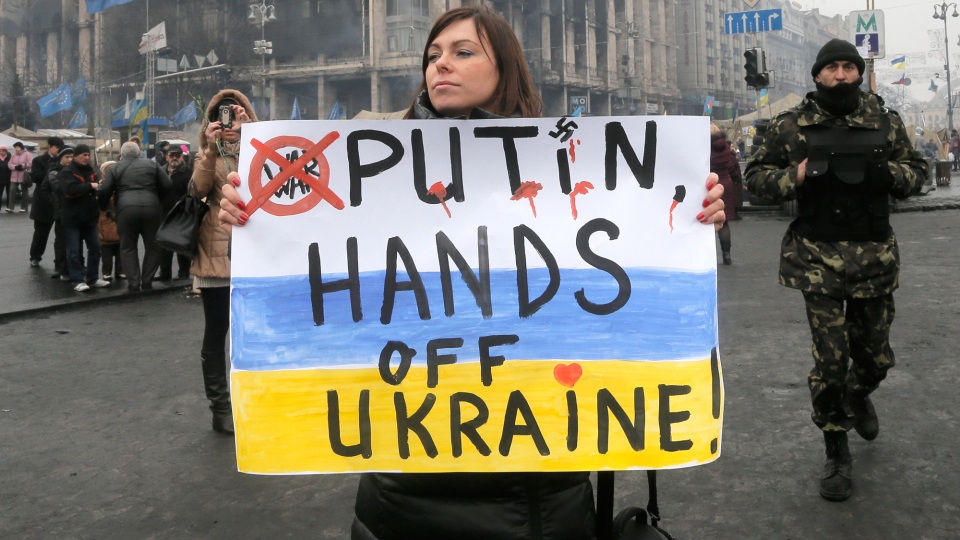 A woman holds a poster against war at Kyiv's Independence Square, in Ukraine, Thursday, March 6, 2014. (AP / Efrem Lukatsky)