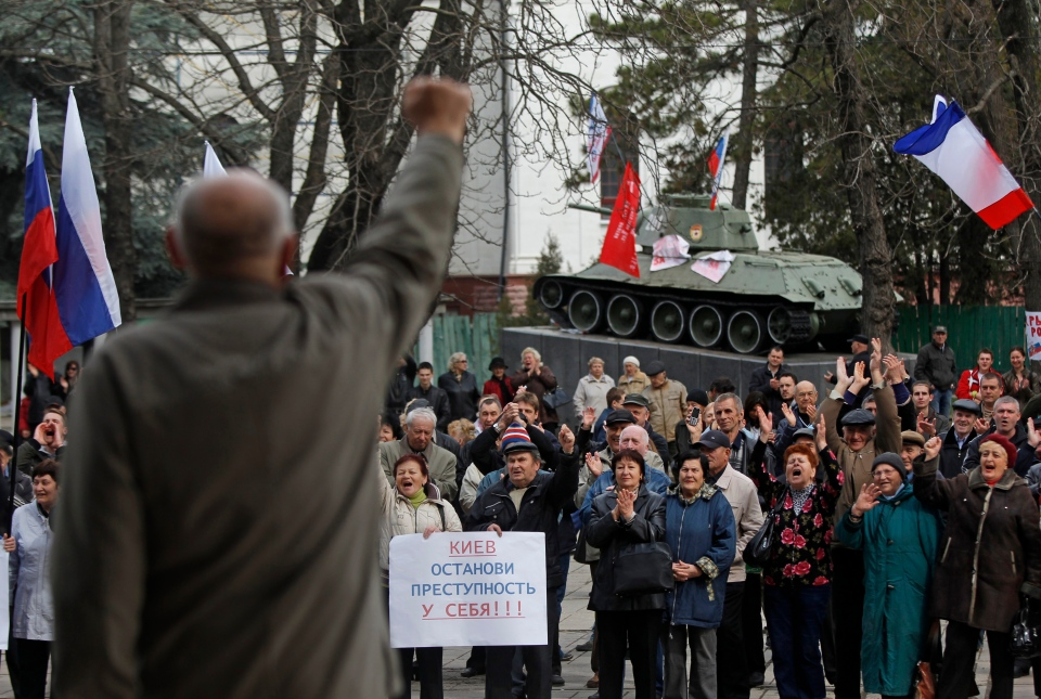 Pro-Russia demonstrators rally at the local parliament building, with a monument of World War II in the background, in Crimea's capital Simferopol, Ukraine, Thursday, March 6, 2014. (AP / Sergei Grits)