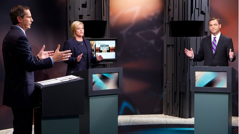 Ontario Liberal Leader Dalton McGuinty, left, NDP Leader Andrea Horwath, centre, and PC Leader Tim Hudak speak during the Ontario election debate in Toronto on Tuesday Sept. 27, 2011. (Frank Gunn /  THE CANADIAN PRESS)