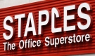 A Staples sign is displayed on the front of a Staples store, in Portland, Ore., in this May 17, 2011 file photo. (AP / Rick Bowmer)