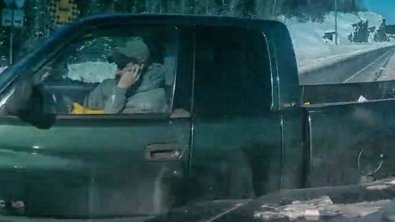 A driver can be seen holding his hand up to his face moments before being hit by a truck on a highway in Northern Ontario on Saturday, March 1, 2014.