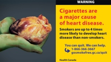 This graphic anti-smoking label is among the 16 new warnings that Health Canada Canada unveiled on Tuesday, Sept. 27, 2011.