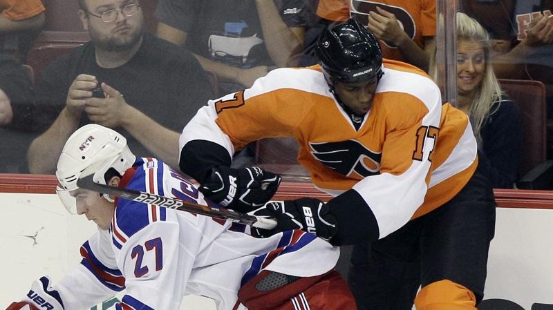Philadelphia Flyers' Wayne Simmonds, right, and New York Rangers' Ryan McDonagh collide in the third period of a preseason NHL hockey game, Monday, Sept. 26, 2011, in Philadelphia. (AP Photo/Matt Slocum)