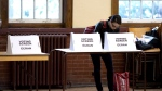 A woman casts her ballot at a voting station in Toronto as voters participate in the Ontario Provincial Election on Thursday October 6, 2011.(Chris Young / THE CANADIAN PRESS)