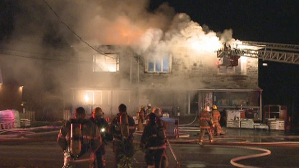 Firefighters from several cities were not able to prevent the destruction of this commercial/residential building at 114 St. Laurent in Maple Grove (Sept. 27, 2011)