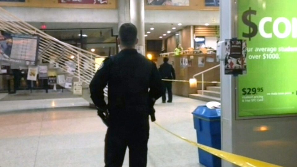 Toronto police investigate a shooting at York University on Thursday, March 6, 2014.