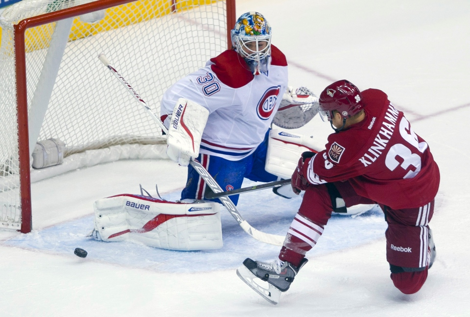 Montreal Canadiens' Peter Budaj, left, makes a save against a close shot from Phoenix Coyotes' Rob Klinkhammer in the first period of an NHL hockey game on Thursday, March 6, 2014, in Glendale, Ariz. (AP Photo/The Arizona Republic, Patrick Breen)