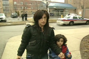 The mother and her son walk into the 31 Division police station in Toronto following the incident.