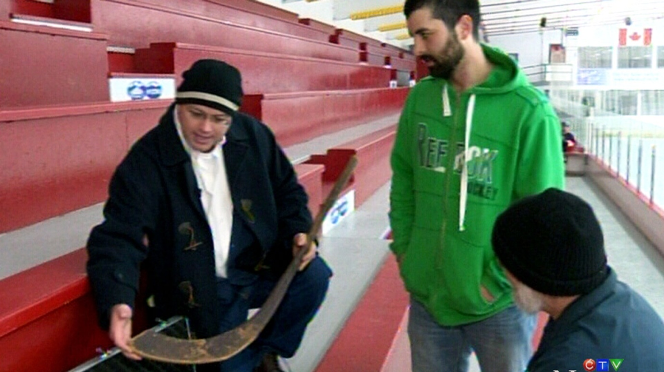 Mark Presley shows off the world's oldest hockey stick at an arena in N.S.