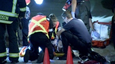 Emergency crews try to revive Maple Batalia at a parking garage at Simon Fraser University's Surrey campus early Wednesday, Sept. 28, 2011.
