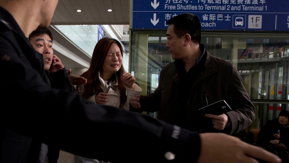 A woman cries at the arrival hall of the International Airport in Beijing, China, Saturday, March 8, 2014. (AP / Ng Han Guan)