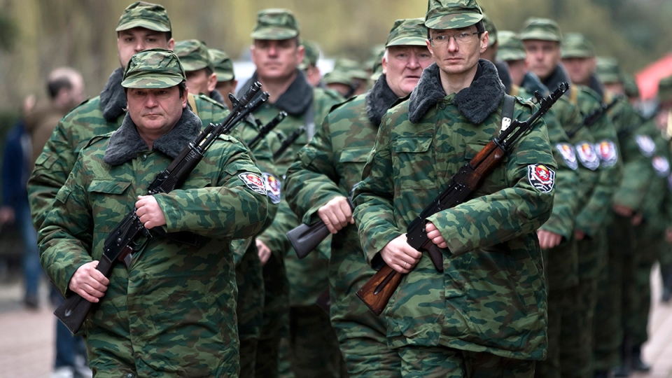 "Armed members of the first unit of a pro-Russian armed force, dubbed the ""military forces of the autonomous republic of Crimea"" march before the swearing-in ceremony in Simferopol, Ukraine, Saturday, March 8, 2014. (AP / Vadim Ghirda)"