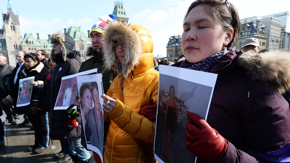 A vigil is held on Parliament Hill in Ottawa for Loretta Saunders and to call for a national inquiry into missing and murdered aboriginal women on Wednesday, March 5, 2014. (Sean Kilpatrick / THE CANADIAN PRESS)