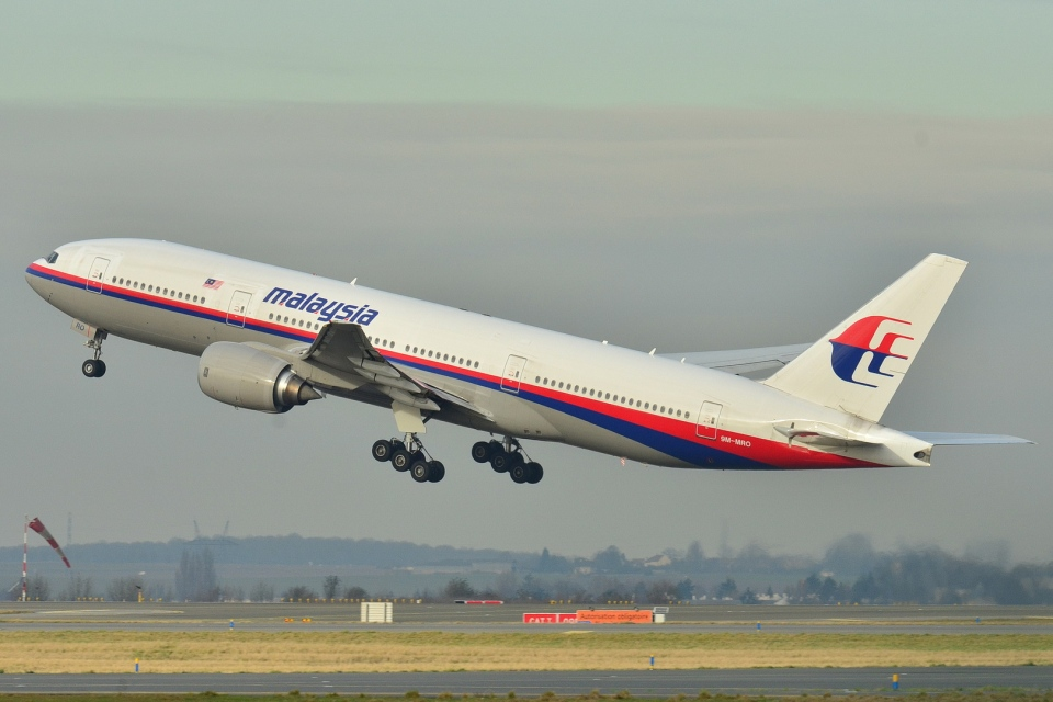 This photo provided by Laurent Errera taken Dec. 26, 2011, shows the Malaysia Airlines Boeing 777-200ER that disappeared from air traffic control screens Saturday, taking off from Roissy-Charles de Gaulle Airport in France. (AP / Laurent Errera)