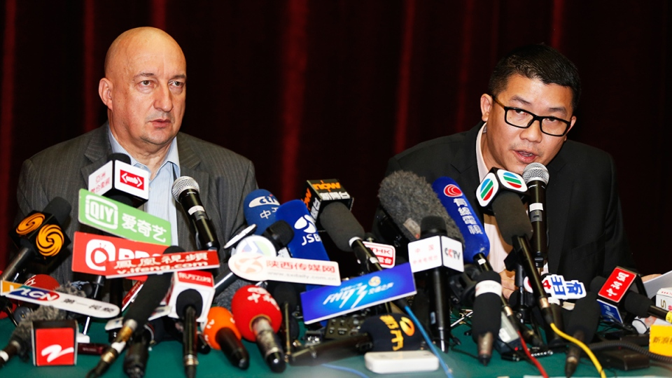 Ignatius Ong, right, and Hugh Dunleavy from Malaysia Airlines speak during a press conference in Beijing, China, Sunday, March 9, 2014. (AP / Vincent Thian)