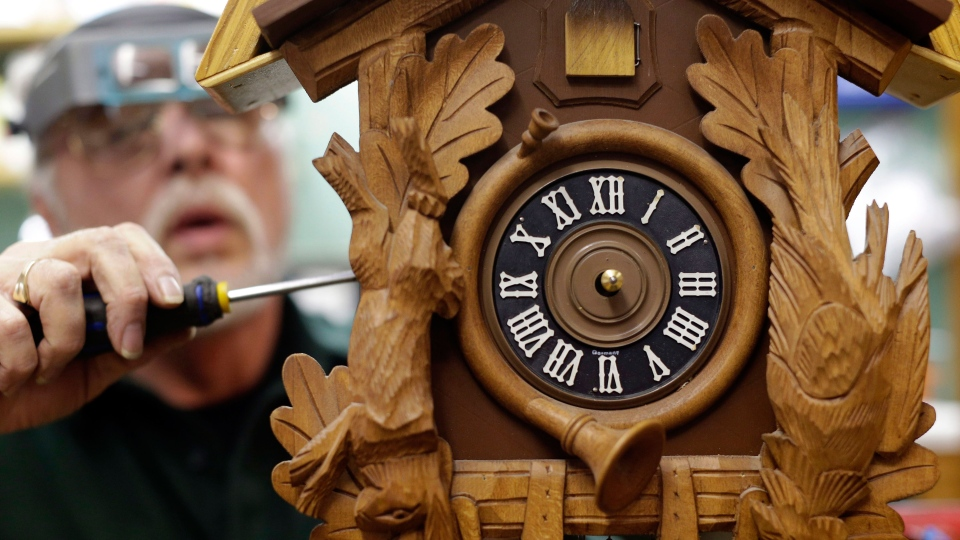 Ken Peters repairs a cuckoo clock in Hands of Time, a clock store and repair shop in Savage, Md., Friday, March 8, 2013. (AP / Patrick Semansky)